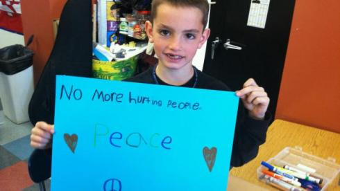 boston bombing boy with sign for peace