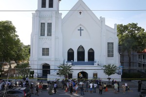 CHARLESTON, SC - JUNE 18:  People stand outside the Emanuel AME Church after a mass shooting at the church that killed nine people on June 18, 2015, in Charleston, South Carolina. A 21-year-old suspect, Dylann Roof of Lexington, South Carolina, was arrersted Thursday during a traffic stop. Emanuel AME Church is one of the oldest in the South. (Photo by Joe Raedle/Getty Images)