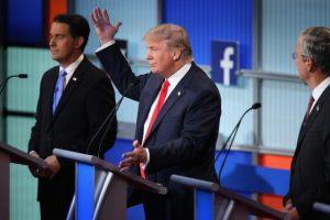 trump hand raised