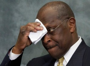 Republican presidential candidate Herman Cain wipes his brow as he speaks at the Congressional Health Caucus Thought Leaders Series, Wednesday, Nov. 2, 2011, on Capitol Hill in Washington. (AP Photo/Carolyn Kaster)