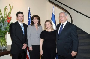 JERUSALEM, ISRAEL - MARCH 21: In this handout image provided by the Israeli Government Press Office, Former Alaska Gov. Sarah Palin (2L) and her husband Todd Palin (L) meet with Prime Minister Benjamin Netanyahu (R) and his wife Sara Netanyahu March 21, 2011 in Jerusalem, Israel. Palin began a private visit to Israel yesterday and is planning to tour holy sites. (Photo by Amos Ben Gershom/GPO via Getty Images)