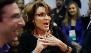 """Former Alaska Gov. Sarah Palin reacts while meeting people during an event to promote her television show, """"Amazing America with Sarah Palin,"""" at the Shooting, Hunting and Outdoor Trade Show, Thursday, Jan. 22, 2015, in Las Vegas. (AP Photo/John Locher)"""