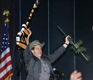 ted nugent gun and guitar