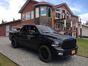 tripp plate house black truck