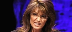 Former vice presidential candidate Sarah Palin addresses attendees at the National Tea Party Convention in Nashville, Tenn., Saturday, Feb. 6, 2010.  (AP Photo/Ed Reinke)
