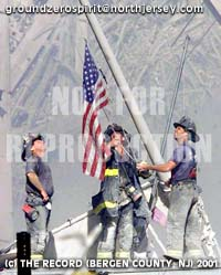 NYC, NY 09/11/01 WTCCRASH : Firemen raised a flag where WTC was. -Thomas E. Franklin / The Record