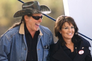 Rocker Ted Nugent and Sarah Palin laugh before a rally for Republican senate candidate John Raese at Haddad Riverfront Park in Charleston, W.Va., on Saturday, Oct. 30, 2010. (AP Photo/Jon C. Hancock)