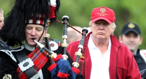 ABERDEEN, SCOTLAND - JULY 10: Donald Trump arrives for the opening of The Trump International Golf Links Course on July 10, 2012 in Balmedie, Scotland. The controversial ?100m course opens to the public on Sunday July 15. Further plans to build hotels and homes on the site have been put on hold until a decision has been made on the building of an offshore windfarm nearby. (Photo by Ian MacNicol/Getty Images)