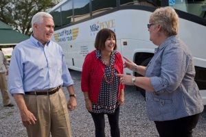 Indiana Gov. Mike Pence, left, and his wife Karen Pence, center, talks with Bartholomew County Republican Party Chairwoman Barb Hackman at a Start Your Engines campaign rally for Pence at Hackman Farms in Columbus, Ind., Friday, May 13, 2016. Hackman hosted the event at her farm. Mike Wolanin | The Republic