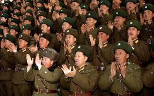 "North Korean soldiers applaud as Supreme Commander of the North Korean People's Army Kim Jong-il visits the 1489 unit of the artillery command at an undisclosed location in North Korea, in this undated picture released by KCNA...North Korean soldiers applaud as Supreme Commander of the North Korean People's Army Kim Jong-il (not pictured) visits the 1489 unit of the artillery command at an undisclosed location in North Korea, in this undated picture released by KCNA January 5, 2009. KCNA did not state expressly the date the picture was taken. The banner reads, ""let's defend to the last with our lives the core group of the revolution headed by the great Kim Jong-il comrade"".   REUTERS/KCNA (NORTH KOREA) QUALITY FROM SOURCE.  NO SALES. NO ARCHIVES. FOR EDITORIAL USE ONLY. NOT FOR SALE FOR MARKETING OR ADVERTISING CAMPAIGNS. NO THIRD PARTY SALES. NOT FOR USE BY REUTERS THIRD PARTY DISTRIBUTORS."